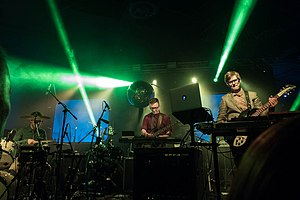 Public Service Broadcasting performing during their The Race for Space Tour in 2015.[a]