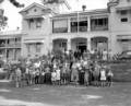 Queensland State Archives 3540 Migrants grouped on the lawn at Yungaba 24 June 1958.png