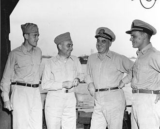 Daniel E. Barbey - Rear Admiral Daniel E. Barbey, USN (2nd from right) with other officers at Hollandia, New Guinea, November 1944. Those present are (from left to right): Lieutenant May; Rear Admiral Arthur D. Struble; Rear Admiral Barbey; and Lieutenant Commander William S. Mailliard, USNR.