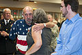 Retired U.S Army Sgt. Frank Spink, second from left, a Vietnam War veteran, hugs his daughter, Deanna Bryant, after receiving a Silver Star Medal at the Indiana Joint Force Headquarters in Indianapolis, Ind 120808-A-MG787-053.jpg