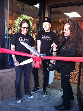 Cowtown Guitars - Guitarist Jake E. Lee cuts the ribbon at Cowtown's grand reopening ceremony in Las Vegas in 2012.