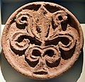 Rossette with a tree motif or alternating leaves. From Qasr Al-Kharanah, early 8th century CE. Pergamon Museum.jpg