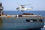 SA330 Puma over flight deck of USNS Cesar Chavez (T-AKE-14) 2013.JPG