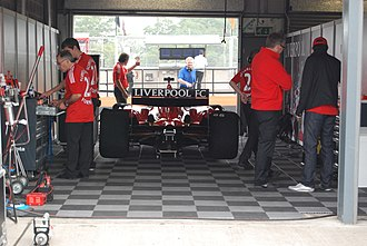 Liverpool F.C. (Superleague Formula team) - The Liverpool car in their pit garage during the 2008 Donington weekend.