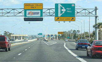 Toll road - A high-speed toll booth on SR 417 near Orlando, Florida, United States.