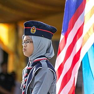 Persekutuan Pengakap Malaysia - A Malaysian Girl Scout at the parade during the celebrations of Hari Merdeka 2013.