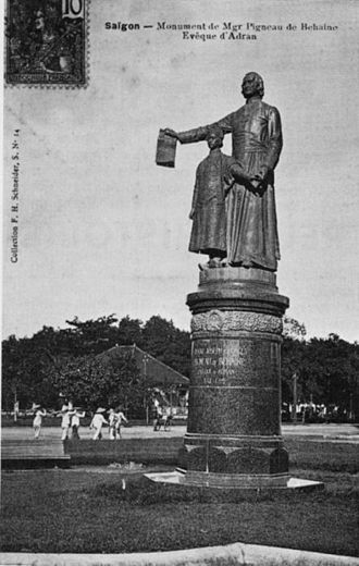 Nguyễn Phúc Cảnh - Statue of Pigneau de Béhaine, with Prince Canh, holding the Treaty of Versailles, in Saigon.