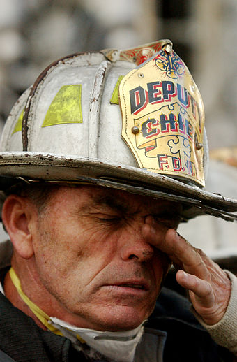 A FDNY deputy chief during rescue efforts at the World Trade Center following the September 11, 2001 attacks. September 14 2001 Ground Zero 03.jpg