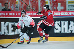 Severin Blindenbaher (L), Jamie Benn (R) - Switzerland vs. Canada, 29th April 2012.jpg