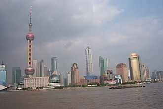 Lujiazui - Lujiazui skyline, as seen from the Bund, across the Huangpu River, with the Shanghai Tower nearing completion