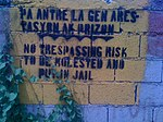 Sign on airport fence, Port-au-Prince 2014.jpg