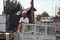 Silk Road 1992 (4367448585) Hawker in Xinjiang selling 罐罐馍.jpg