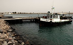Small tugboat and pier in Obock, Djibouti.jpg