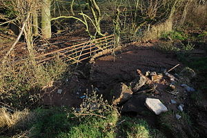 Agricultural pollution - Soil erosion: soil has washed from a ploughed field through this gate and into a watercourse beyond.