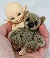Soso and his teddybear, Acorn (6945631359).jpg