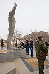 Soyuz MS-11 backup crew at the statue of Yuri Gagarin in Baikonur.jpg