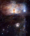 Spectacular star-forming region known as the Flame Nebula, or NGC 2024.jpg