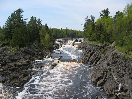 Tilted beds of the Middle Precambrian Thomson Formation in Jay Cooke State Park StLouisRiver JayCooke.JPG