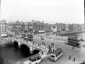 Dublin United Transport Company - Straight on or left or right to Westmoreland Street only, with a busy O'Connell Bridge in the 1930s with double decker trams.