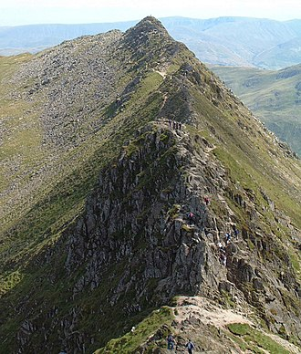 Arête - Striding Edge, an arête viewed from Helvellyn with the corrie Red Tarn to the left and Nethermost Cove to the right