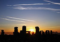 The sun rising over Stonehenge at the 2005 Sum...