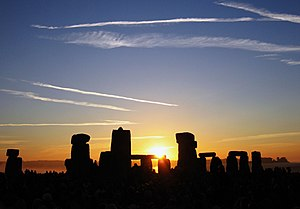 The sun rising over Stonehenge on the summer s...
