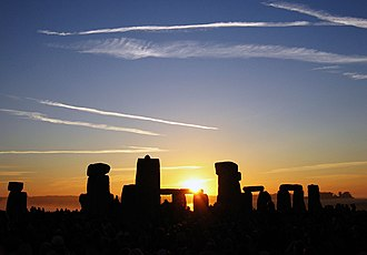History of timekeeping devices - The sun rising over Stonehenge on the June solstice