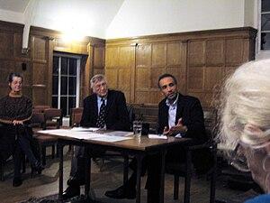 Tariq Ramadan (at table, right) speaking in Ox...