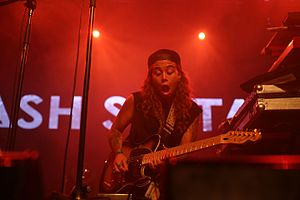 Tash Sultana - Tash Sultana playing guitar at her live performance in Melbourne
