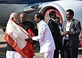 The Prime Minister, Shri Narendra Modi being welcomed by the Governor of Andhra Pradesh and Telangana, Shri E.S.L. Narasimhan and the Chief Minister of Telangana, Shri Chandrashekar Rao, on his arrival, at Hyderabad.jpg