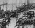 The rain-swept Boston Fish Pier, crowded with fish carts, fishing boats, and workmen, ca. 1950 - NARA - 541953.tif