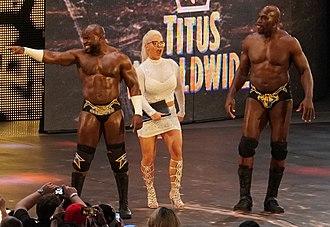 Dana Brooke - Brooke along with her fellow Titus Worldwide partners Apollo Crews (left) and Titus O'Neil (right) in April 2018