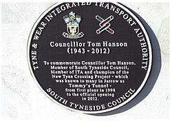 Photo of Tom Hanson black plaque