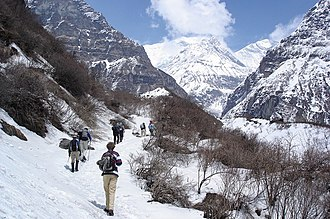 Economy of Nepal - Tourists trekking in Annapurna region in western Nepal. Tourism plays a vital role in Nepal's economy.
