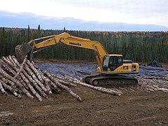 Tracked Excavator placing Corduroy