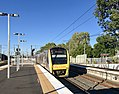Train approaching Corinda railway station, Queensland.jpg