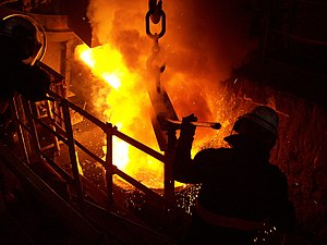 Transferring molten metal from the furnace to the ladle.jpg