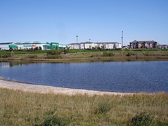 Retention basin - Trounce Pond, a retention basin landscaped with natural grassland plants, in Saskatoon, Saskatchewan, Canada
