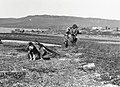 Two Inuit and a dog walking near Tree River (38506).jpg