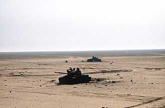 Battle of Kuwait International Airport - Two destroyed Iraqi T-62 tanks on the battlefield, February 1991.