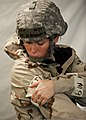 U.S. Airman 1st Class Marianna Benasutti, with the 96th Medical Operations Squadron, secures M9 tape, which detects the presence of chemical agents, to her chemical warfare suit during a training exercise 110810-F-OC707-011.jpg