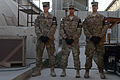 U.S. Airmen assigned to the 455th Air Expeditionary Wing honor guard await the start of a retreat ceremony at Bagram Airfield in Parwan province, Afghanistan, Sept 140911-F-LX971-003.jpg