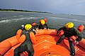 U.S. Airmen with the 305th Air Mobility Wing sit in a raft while conducting recurrent water survival training in the bay near Coast Guard Station Barnegat Light, N.J. 110818-F-CA540-139.jpg