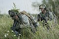 U.S. Army Sgt. 1st Class Alan Lunna, left, a platoon leader, and Sgt. Timothy Farrow, a medic, both with Bravo Troop, 1st Squadron, 172nd Cavalry Regiment, 86th Infantry Brigade Combat Team, Vermont Army 130813-Z-KE462-088.jpg