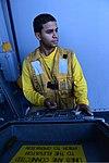 U.S. Navy Aviation Boatswain's Mate (Handling) 3rd Class Ernesto Rivera operates an elevator control panel aboard the amphibious assault ship USS Kearsarge (LHD 3) in the Red Sea June 11, 2013 130611-N-NB538-168.jpg
