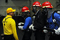 U.S. Navy Aviation Boatswain's Mate 1st Class Cesar Rivera instructs Sailors in proper fire fighting techniques aboard the aircraft carrier USS George H.W. Bush (CVN 77) in the Atlantic Ocean May 20, 2013 130520-N-CZ979-258.jpg