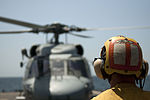 U.S. Navy Boatswain's Mate 3rd Class Billy Lewis acts as the landing signalman enlisted as a Navy SH-60B Seahawk helicopter assigned to Helicopter Anti-Submarine (Light) Squadron (HSL) 48 prepares to launch from 120905-N-NL541-055.jpg