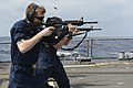 U.S. Navy Cryptologic Technician (Collection) 2nd Class Steven Jenkins, assigned to guided missile destroyer USS Lassen (DDG 82), participates in a live-fire exercise aboard the ship March 18, 2014, in 140318-N-ZZ999-034.jpg