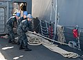 U.S. Sailors aboard the guided missile frigate USS Ford (FFG 54) heave a line after detaching from the guided missile destroyer USS Spruance (DDG 111) upon departure from Esquimalt, British Columbia, Canada 130503-N-QY316-025.jpg