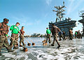 US Navy 020427-N-3986D-001 USS Washington - flight deck scrub down.jpg